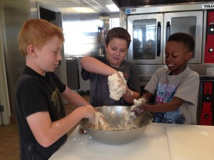 Dwyer, Alex and Jamaal are having a blast digging into the dough.