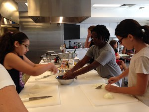 Sophia (left), Landry (center) and Olivia (right) get right into chopping the vegetables for the egg dishes.