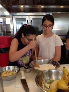 Sophia (left) and Olivia (right) carefully mix the banana pancake batter.
